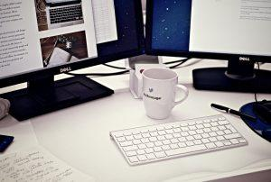 Mug In Front Of Computer